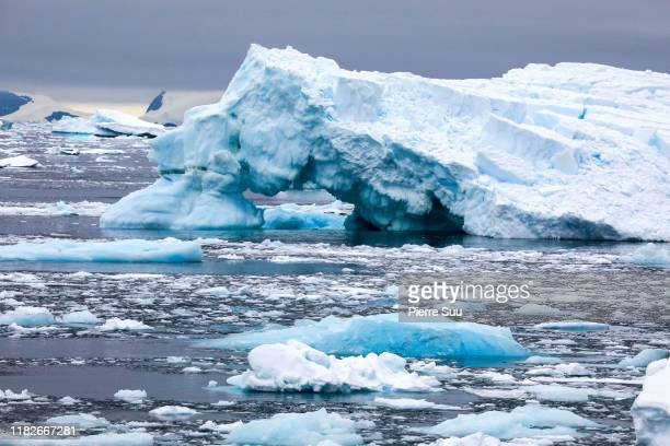 An iceberg is seen near 'Charcot Port' onFebruary 27, 2019 in Antarctica sea.