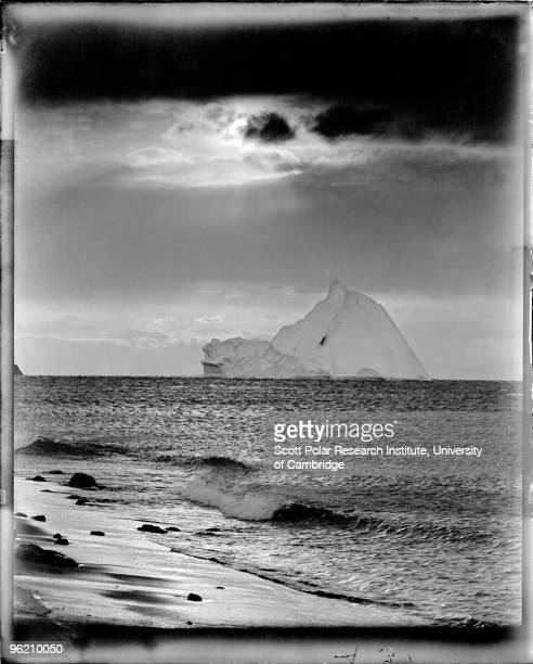 An iceberg off the coast of Cape Evans on Ross Island in the Ross Dependency of Antarctica during Captain Robert Falcon Scott's Terra Nova Expedition...