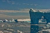 an iceberg with hole seen through
