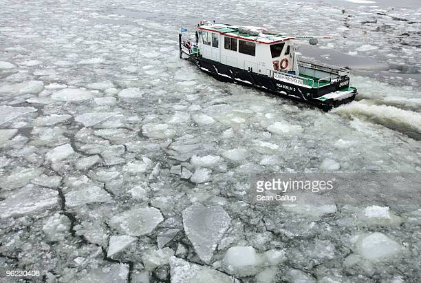 An icebreaker churns through ice in the Dahme river in the district of Koepenick on January 28 2010 in Berlin Germany Though temperatures are mild...