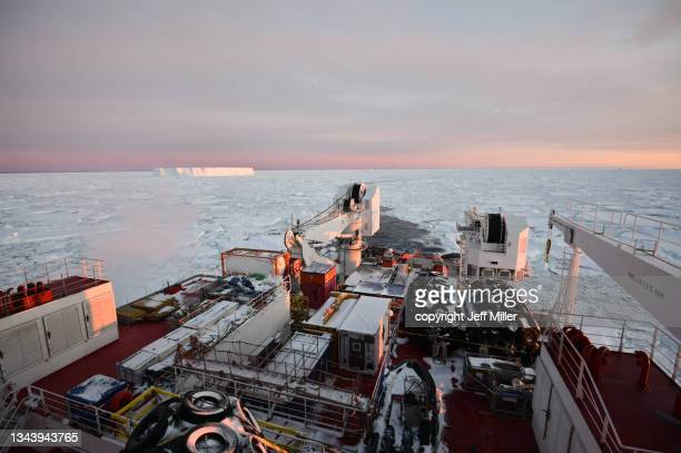 an icebreaker cuts through a sea of ice, southern ocean, antarctica. - pack ice stock pictures, royalty-free photos & images