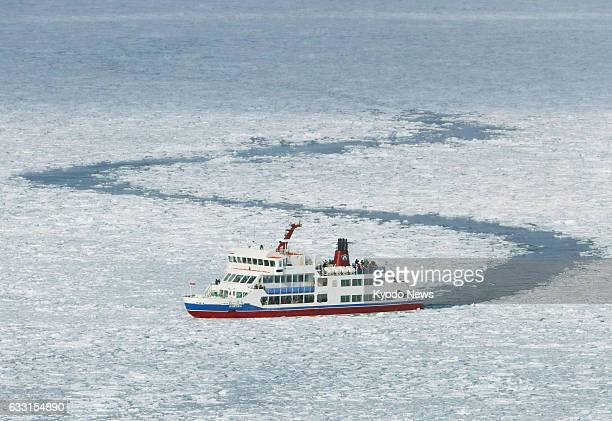 An icebreaking ship carrying tourists sails through drift ice in the Sea of Okhotsk off Abashiri on Japan's northernmost main island of Hokkaido on...