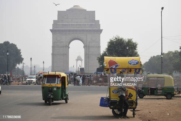 An icecream vendor waits for customers under heavy smog near India Gate in New Delhi on October 28 2019 Air quality in the Indian capital turned...