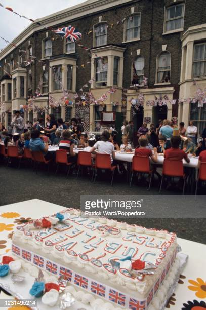 An iced cake at a children's street party celebrating the Silver Jubilee of Her Majesty Queen Elizabeth II in Fulham, London on 7th June 1977.