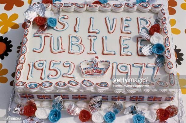 An iced cake at a street party celebrating the Silver Jubilee of Her Majesty Queen Elizabeth II in Fulham, London on 7th June 1977.