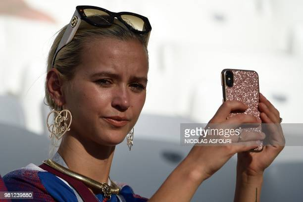 An Iceland's fan checks her smartphone as she waits in the grandstand before the Russia 2018 World Cup Group D football match between Nigeria and...