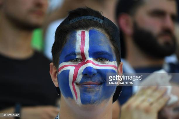 An Iceland's fan smiles before the Russia 2018 World Cup Group D football match between Nigeria and Iceland at the Volgograd Arena in Volgograd on...