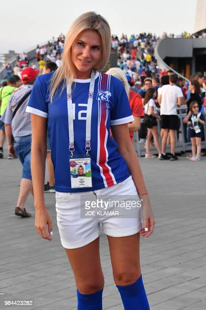 An Iceland's supporter poses ahead of the Russia 2018 World Cup Group D football match between Iceland and Croatia outstide the Rostov Arena in...