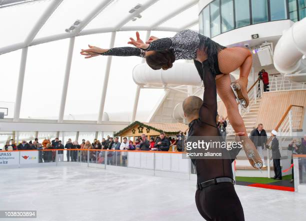An iceskating couple from the 'Holiday on Ice' show skate on a rink on the deck of the 'Aida prima' cruise ship in Hamburg Germany 12 November 2016...
