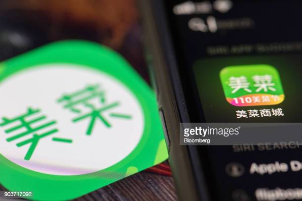 An icon for the Meicai application is displayed on a smartphone in an arranged photograph taken in Hong Kong China on Thursday Jan 11 2018 Meicai a...