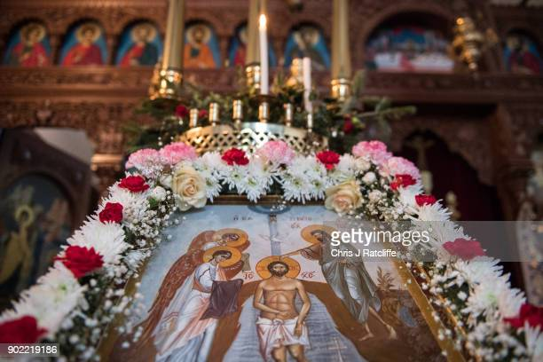 An icon of the baptism of Chirst is seen during a traditional Greek Orthodox service at the Church of St Michael the Archangel for the Feast of the...