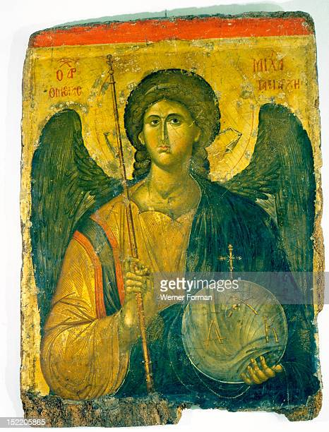 An icon with the image of the Archangel St Michael holding a staff and a globe surmounted by the Cross Greece Byzantine 14th century