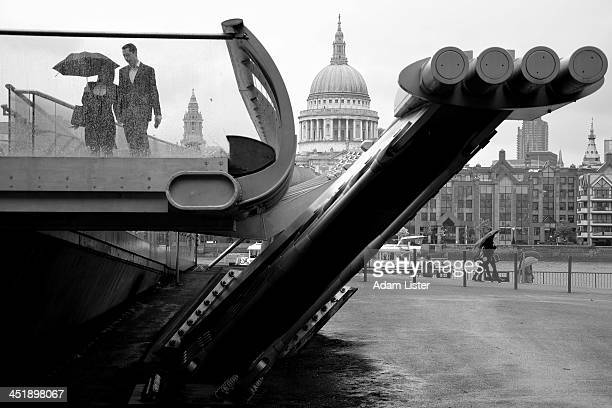 CONTENT] An iconic cityscape showing the end of the Millennium Bridge in London It frames the famous Dome of St Pauls Cathedral in the City of London...