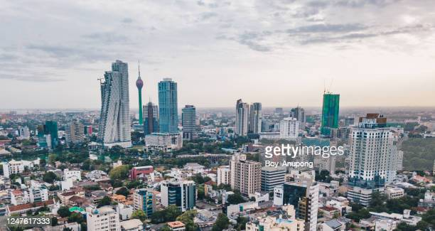 an iconic lotus tower located at the centre of colombo cityscape in sri lanka. - sri lanka stock pictures, royalty-free photos & images