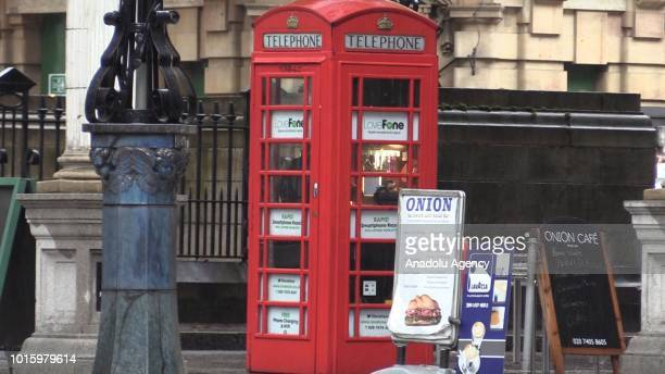 An iconic Red English Telephone booth used as a phone repair shop by Morocconorigin Fouad Choaibi is seen at Hollborn district of London United...