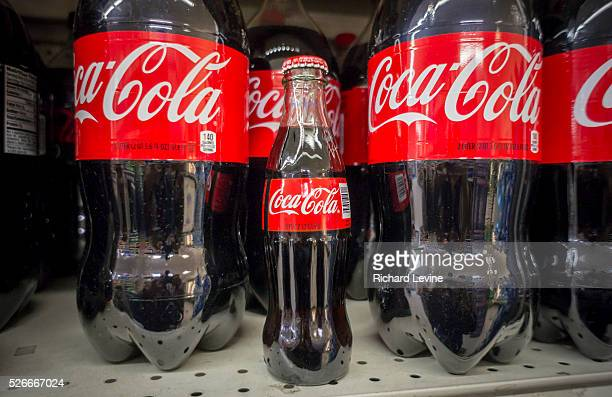 An iconic trademarked bottle of CocaCola on a supermarket shelf in New York on Monday March 2 2015 2015 The CocaCola Co is scheduled to report its...