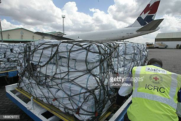 An ICRC official inspects relief supplies 20 October 2005 at the the Jomo Kenyatta International Airport Nairobi bound for Pakistan to aid desperate...