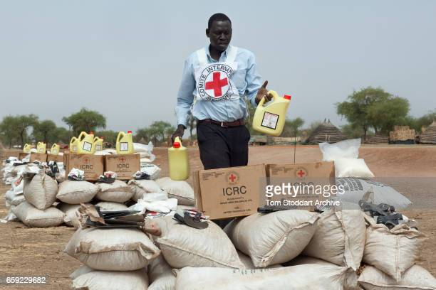 An ICRC worker in Abathok village during an International Committee of the Red Cross distribution of seeds agricultural tools and food staples to...