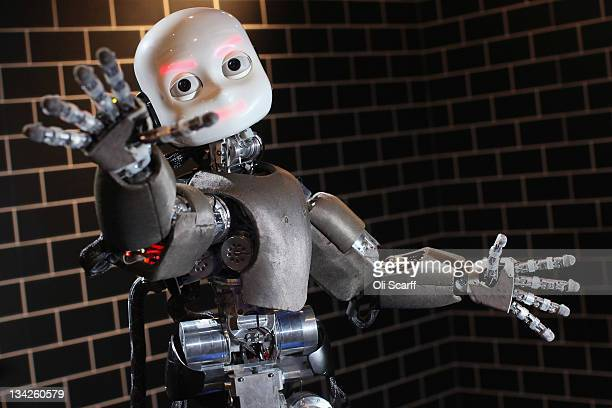 An iCub robot built by the Italian Institute of Technology tracks a ball in the Robotville exhibition at the Science Museum on November 29 2011 in...