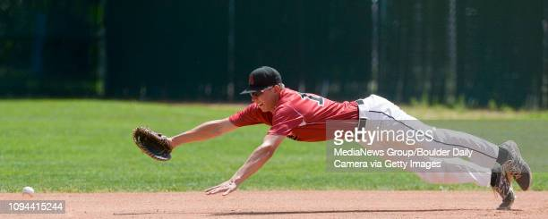 An Idaho Falls' hit gets by Colorado Aces' Corey Grace in the second inning during the Boulder National Invitational Tournament championship game...