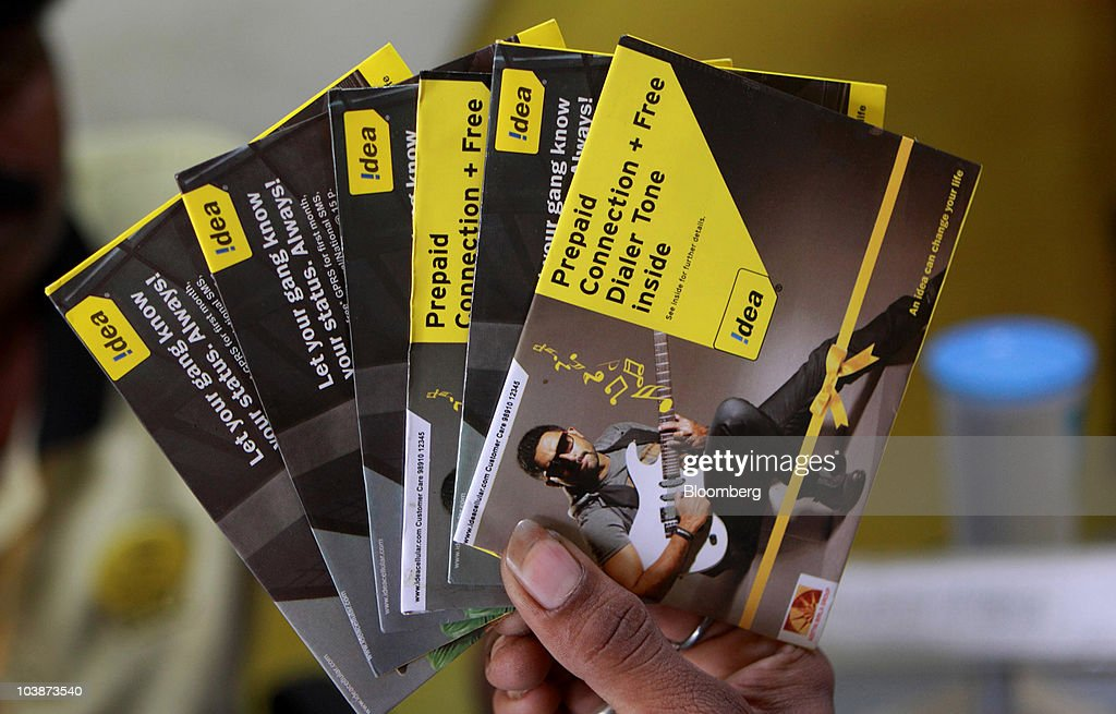 An Idea Cellular Ltd  employee displays SIM card packages