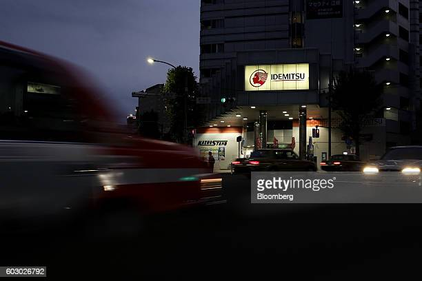 An Idemitsu Kosan Co gasoline station stands at dusk in Tokyo Japan on Friday Aug 12 2016 At an Idemitsu shareholder meeting in June investors were...