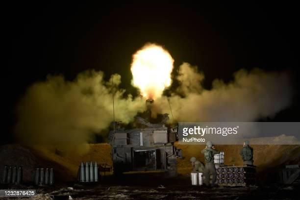 An IDF artillery unit fires towards Gaza Strip near the Israel-Gaza border in Southern Israel, May 13, 2021.