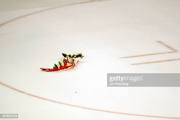 An idian headress lies on the ice after the Detroit Red Wings won 6-1 against the Chicago Blackhawks during Game Four of the Western Conference...
