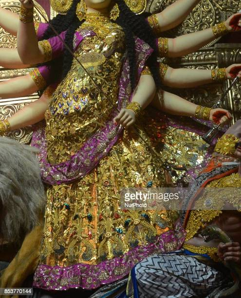 An Idol goddess of Durga with a saree made of 22 kgs of gold beautified with zari work embossed on it at Santosh Mitra Square Puja pandal in Kolkata...
