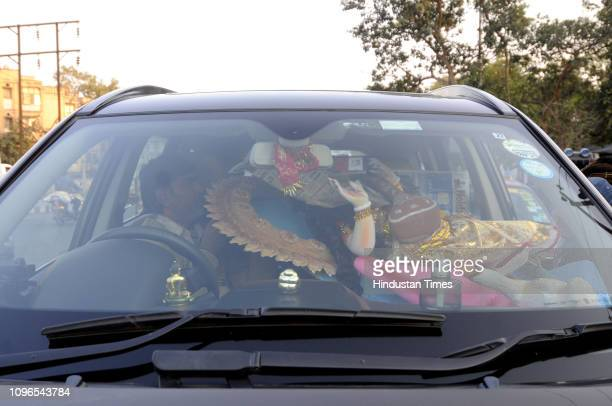 An idol is loaded in a customer's car ahead of the upcoming Saraswati Puja at Sector 20 on February 9 2019 in Noida India Basant Panchami or Vasant...