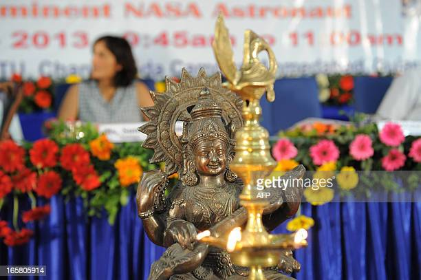 An idol of Goddess Saraswati is seen in the foreground as US astronaut of IndianSlovenian origin Sunita Williams visits Gujarat Technological...