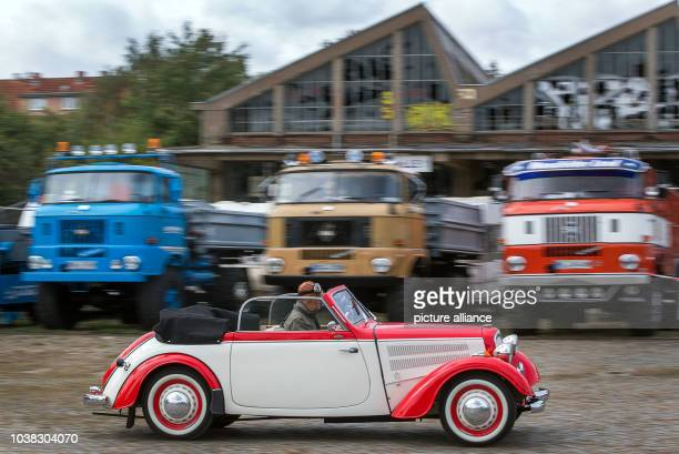 An IFA F8 Cabrio from the 1950s drives across the grounds of the former vehicle maintenance factory 'Fortschritt' in Schwerin Germany 30 September...