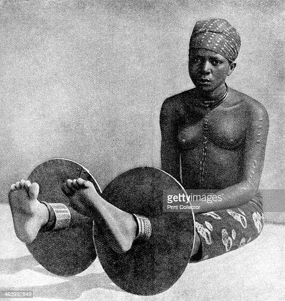 An Igbo woman wearing ankle plates Nigeria West Africa 1922 From Peoples of All Nations Their Life Today and the Story of Their Past volume I...