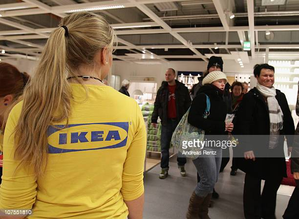 An Ikea employee watches customers shopping during a store opening at the 4th Ikea chain store in Berlin Lichtenberg on December 13 2010 in Berlin...