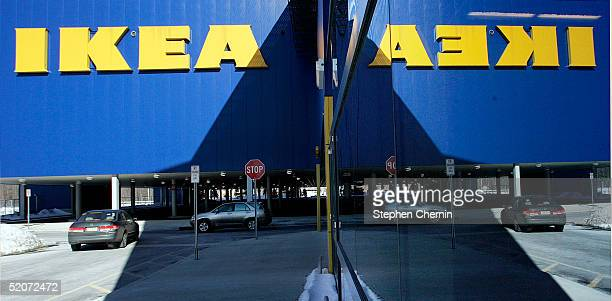 An IKEA sign is reflected in mirrored side of the building of an Ikea store January 27 2005 in Paramus New Jersey Ikea a Swedish company currently...