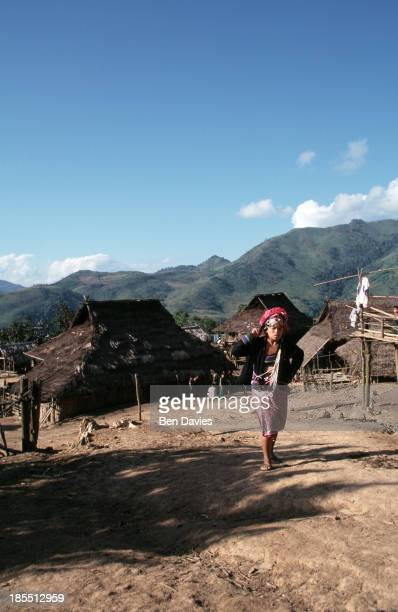 An Iko woman leaves the village of Sopee for the two day walk down the remote mountainside to Muang Sing in Northern Laos These hilltribes people are...