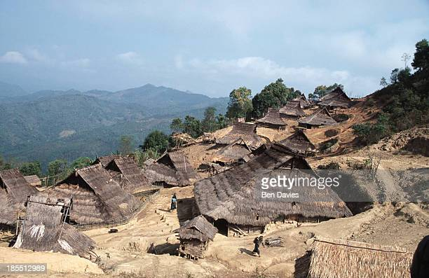 An Iko woman walks through the village of Ban Perhisang Khao situated high up in the mountains a two day walk from Phongsali in Northern Laos The Iko...