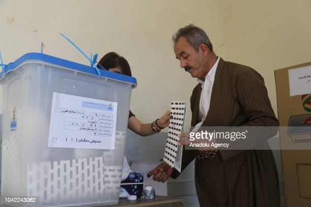 An IKRG's security officer who will be on duty during the elections casts his vote earlier for the parliamentary elections at an elementary school in...