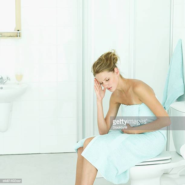 an ill woman in the bathroom