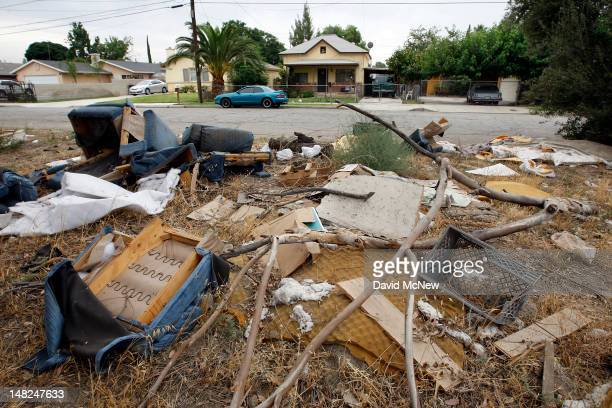 An illegal dump site in a residential neighborhood remains unattended to on July 12 2012 in San Bernardino California The San Bernardino City Council...