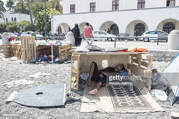 An illegal immigrant sleeps on a beach in Greece's Kos island on September 4 2015 Migrants who have illegally travelled from Mugla's Bodrum district...