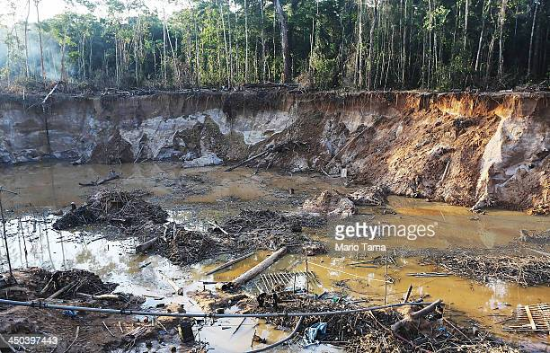 An illegal mining operation is seen in the Amazon lowlands on November 17 2013 in Madre de Dios region Peru Police eventually destroyed three pieces...