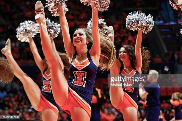 An Illinois Fighting Illini cheerleader is seen during the game against the Michigan Wolverines at State Farm Center on December 30 2015 in Champaign...