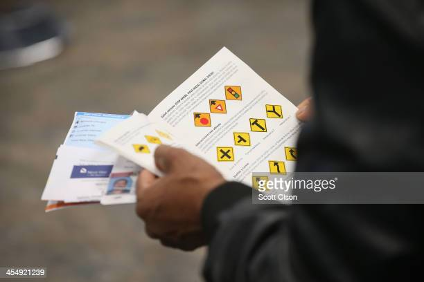 An Illinois resident uses a Spanishlanguage study guide to prepare for his driver's license exam at a driver services facility on December 10 2013 in...