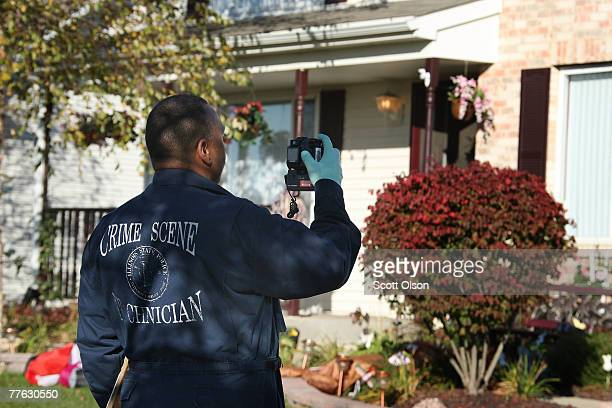 An Illinois State Police crime scene technician photographs the home of Bolingbrook police Sgt Drew Peterson whose fourth wife was recently reported...