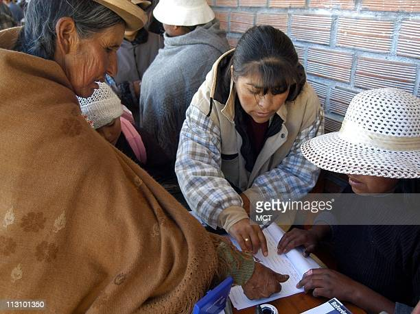 LA PAZ BOLIVIA An illiterate Aymara indian woman stamps her thumb rather than signing the list after voting in a polling station in El Alto a suburb...