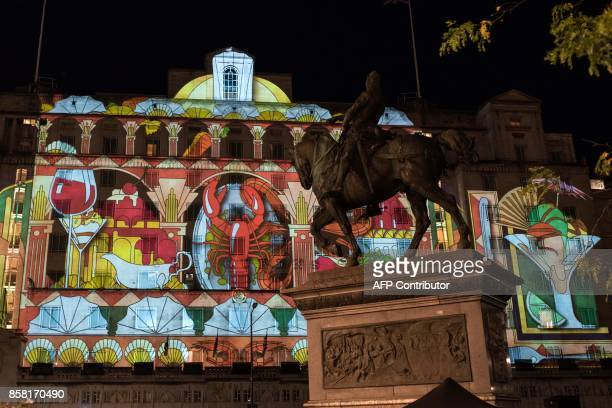 An illuminated art installation entitled 'Harlequin' projected onto the Queens Hotel which features in the annual 'Light Night Leeds' festival of...