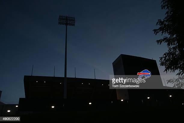 An illuminated Buffalo Bills logo at twilight after the NFL game between the Buffalo Bills and New England Patriots at Ralph Wilson Stadium on...
