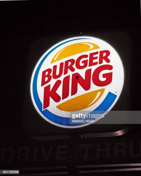 An illuminated Burger King sign is seen on August 25 2014 in Washington DC Fastfood chain Burger King plans to buy Canadian chain Tim Hortons in an...