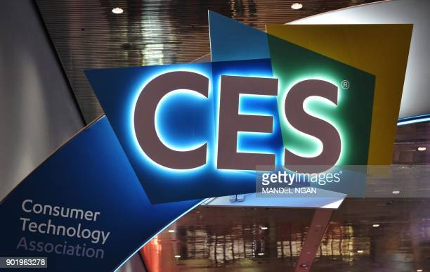 An illuminated CES sign is seen inside of the Las Vegas Convention Center ahead of the opening of the 2018 Consumer Electronics Show in Las Vegas on...
